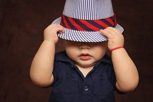 Baby Boy Playing with Hat