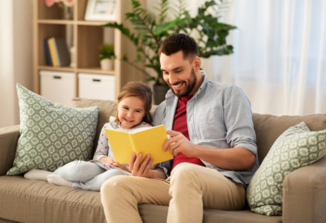 Dad and Child Reading Together